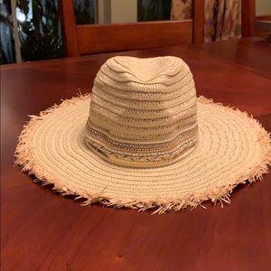 NWT Girl's straw hat with beading around brim.
